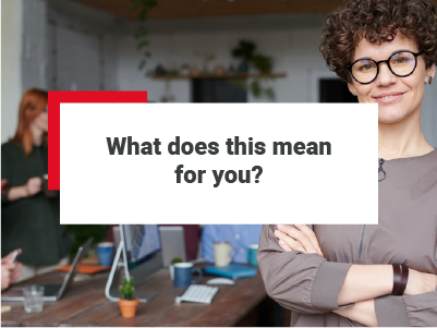 A female real estate professional standing in an office. There are colleagues / other real estate professionals in the background working and having discussions. The text 'what does this mean for you' has been positioned over the image.